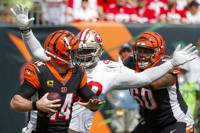 Cincinnati Bengals quarterback Andy Dalton (14) is sacked by San Francisco 49ers defensive tackle DeForest Buckner, center, during the second half an NFL football game, Sunday, Sept. 15, 2019, in Cincinnati. (AP Photo/Frank Victores)