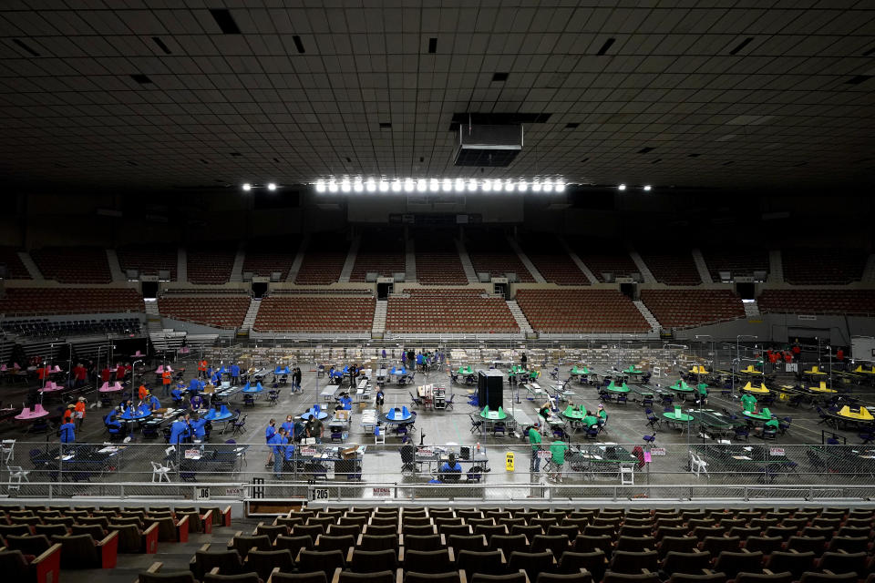 Maricopa County ballots cast in the 2020 general election are examined and recounted by contractors working for Florida-based company, Cyber Ninjas, Thursday, May 6, 2021 at Veterans Memorial Coliseum in Phoenix. (Matt York/AP)