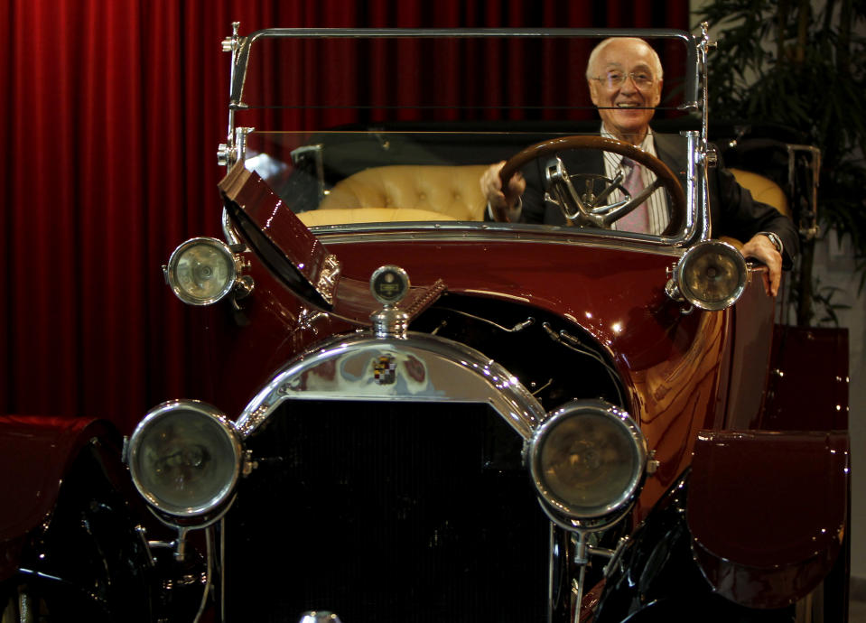 Former advisor to the late King Hussein, Ali Ghadour, sits in a Cadillac Type 53-1916 owned by the late Jordanian King Hussein and displayed with other cars at the Royal Automobile Museum during a ceremony to celebrate the late king's birthday in Amman November 11, 2010. REUTERS/Ali Jarekji (JORDAN - Tags: POLITICS SOCIETY TRANSPORT ROYALS)