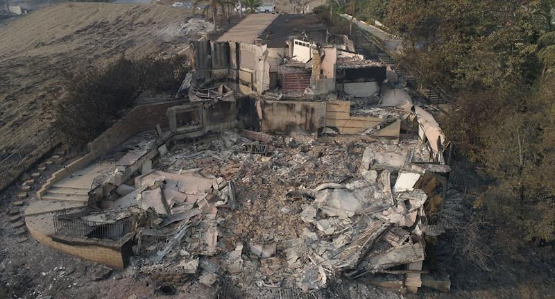 California fires: Drone still of Australian director Neil Johnson's Malibu home, which he shares with actress Tracey Birdsall, after it burned down.