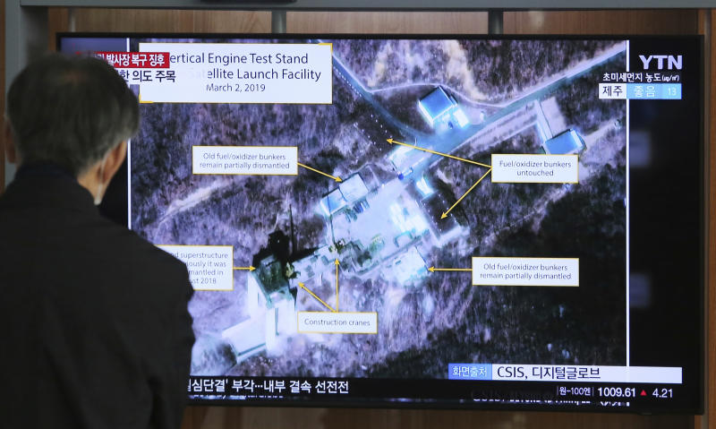 "FILE - In this March 6, 2019 file photo, a man watches a TV screen showing an image of the Sohae Satellite Launching Station in Tongchang-ri, North Korea, during a news program at the Seoul Railway Station in Seoul, South Korea. North Korea said Sunday, Dec. 8, it carried out a ""very important test"" at its long-range rocket launch site that will have a key effect on the country's strategic position. (AP Photo/Ahn Young-joon, File)"