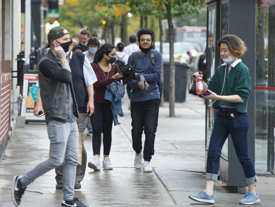 People are seen on St. Catherine Street in Montreal