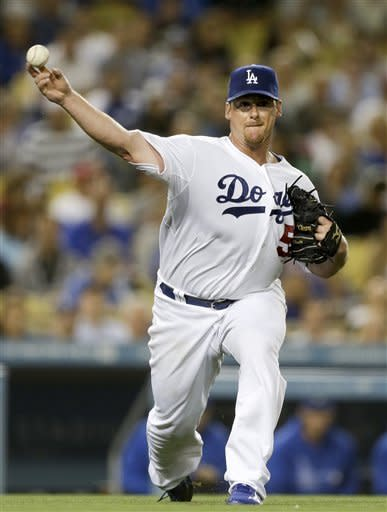 Los Angeles Dodgers starting pitcher Chad Billingsley throws Cincinnati Reds' Homer Bailey out at first during the sixth inning of a baseball game in Los Angeles, Monday, July 2, 2012. (AP Photo/Chris Carlson)