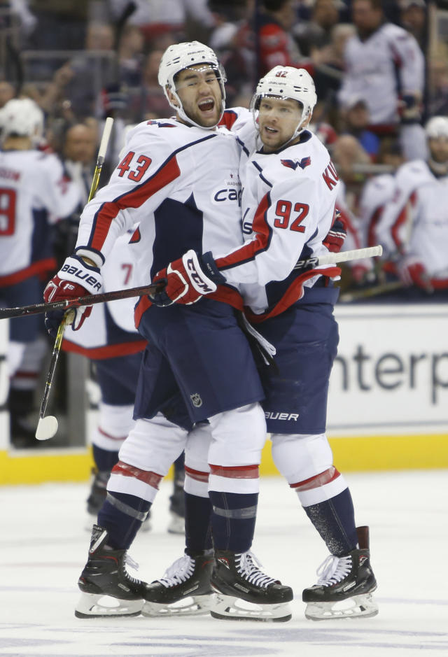Washington Capitals' Tom Wilson, left, celebrates his goal against the Columbus Blue Jackets with teammate Evgeny Kuznetsov, of Russia, during Game 4 of an NHL first-round hockey playoff series Thursday, April 19, 2018, in Columbus, Ohio. (AP Photo/Jay LaPrete)