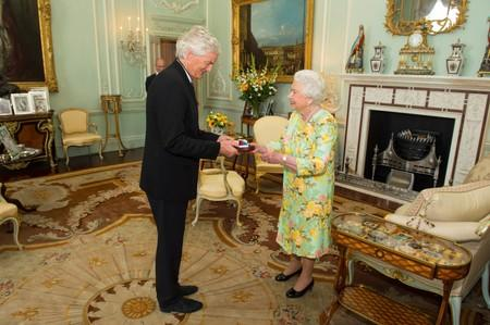 FILE PHOTO: Britain's Queen Elizabeth presents James Dyson with the insignia of members of the Order of Merit, during a private audience at Buckingham Palace, London