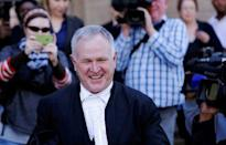 Barry Roux, defence lawyer for Oscar Pistorius, reacts as he leaves court after an appeal hearing brought by prosecutors against the six year jail term handed to Pistorius for the murder of his girlfriend Reeva Steenkamp, in Johannesburg, South Africa August 26, 2016. REUTERS/Siphiwe Sibeko
