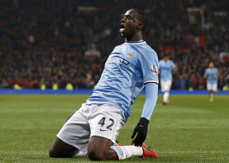 Manchester City's Yaya Toure celebrates his goal against Manchester United during their English Premier League soccer match at Old Trafford in Manchester, northern England, in this March 25, 2014 file photo. REUTERS/Phil Noble/Files