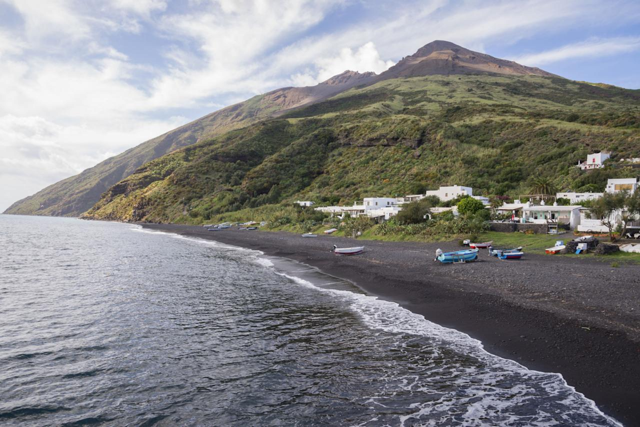 """<p>Nearby volcanoes are usually the reason for black beaches. The """"sand"""" itself is actually made up of tiny pebbles instead of fine grains. For example, the Mediterranean island of <a rel=""""nofollow"""" href=""""http://www.lonelyplanet.com/italy/sicily/stromboli/introduction"""">Stromboli</a> is actually just the tip-top of an enormous underwater volcano.</p><p><a rel=""""nofollow"""" href=""""http://www.housebeautiful.com/lifestyle/g3408/black-sand-beaches/"""">From House Beautiful</a></p>"""