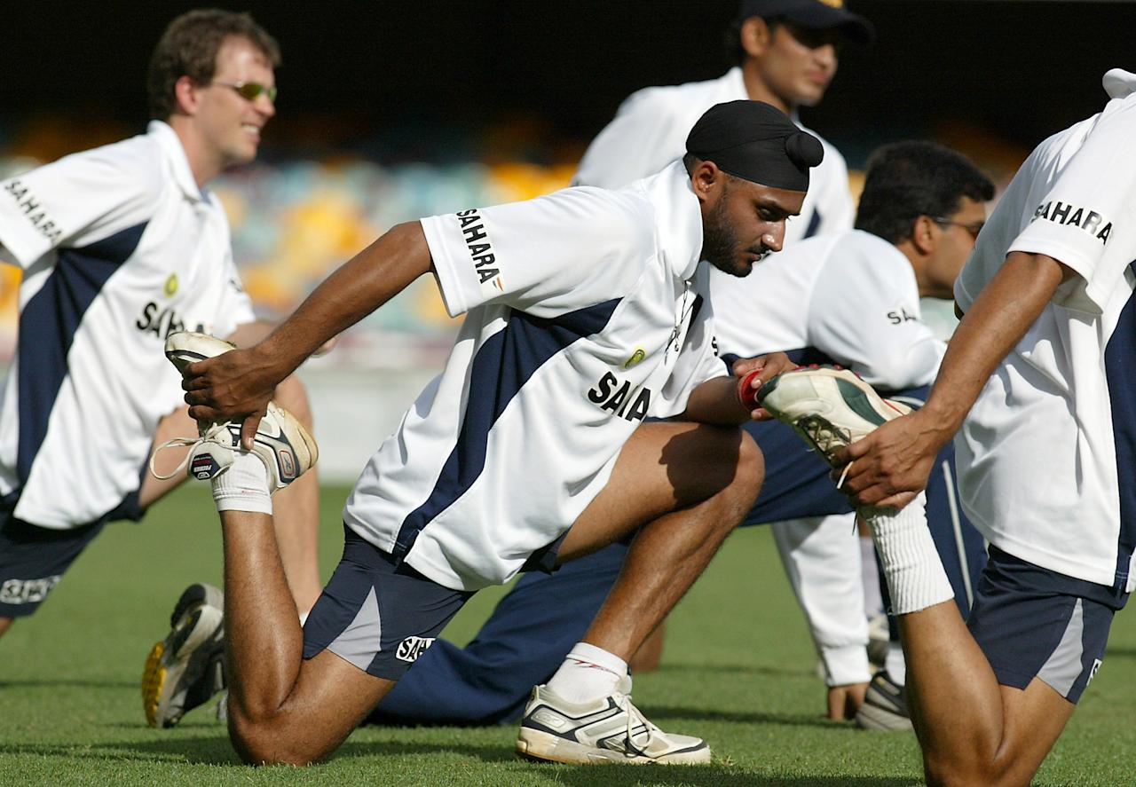 BRISBANE, AUSTRALIA - DECEMBER 2:  Harbhajan Singh of India stretches during a team training session in preperation for the test match against Australia at the Gabba December 2, 2003 in Brisbane, Australia.  (Photo by Jonathan Wood/Getty Images)