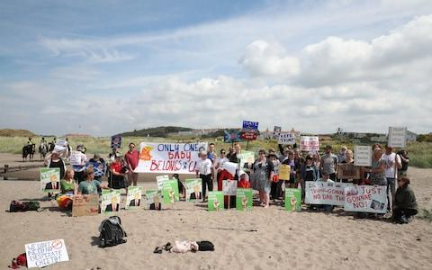 Trump protestors on the beach near to the Trump Turnberry resort in South Ayrshire - Credit: PA