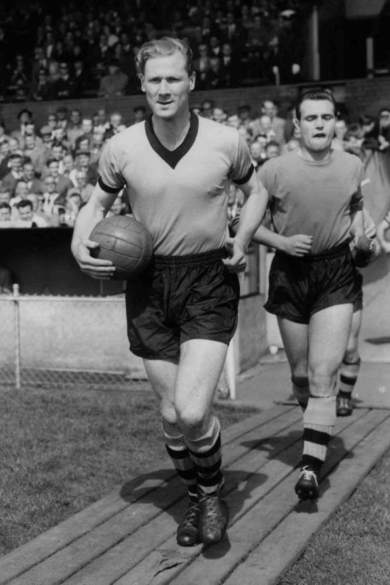 Running out as captain for Wolves in 1960 (Getty)