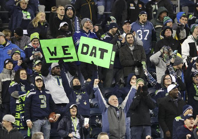 "Seattle Seahawks fans celebrate with a variation on the New Orleans Saints slogan ""Who Dat?"" in the second half of an NFL football game, Monday, Dec. 2, 2013, in Seattle. The Seahawks beat the Saints 34-7. (AP Photo/Scott Eklund)"