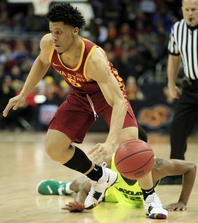 Baylor guard Jared Butler (12) knocks the ball away from Iowa State guard Lindell Wigginton (5) during the first half of an NCAA college basketball game in the quarterfinals of the Big 12 conference tournament in Kansas City, Mo., Thursday, March 14, 2019. (AP Photo/Orlin Wagner)