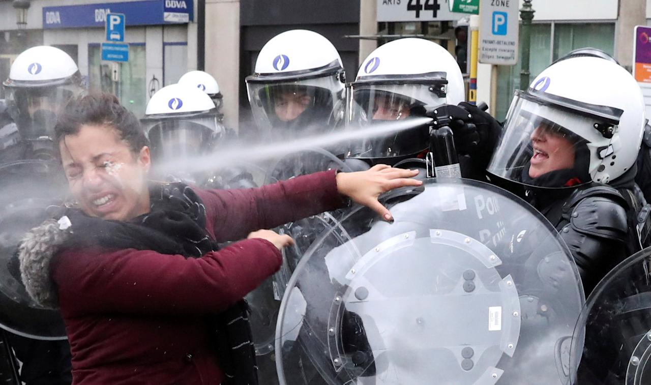 """A woman is sprayed with teargas by the riot police officer during the """"yellow vests"""" protest against higher fuel prices, in Brussels, Belgium, December 8, 2018. REUTERS/Yves Herman/File photo     SEARCH """"TEARGAS HERMAN"""" FOR THIS STORY. SEARCH """"WIDER IMAGE"""" FOR ALL STORIES. TPX IMAGES OF THE DAY."""