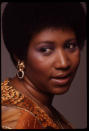 <p>Baby 'fro, purple eyeshadow, and a fresh face is what makes this shot of Aretha Franklin stand out. (Photo by Anthony Barboza/Getty Images) </p>
