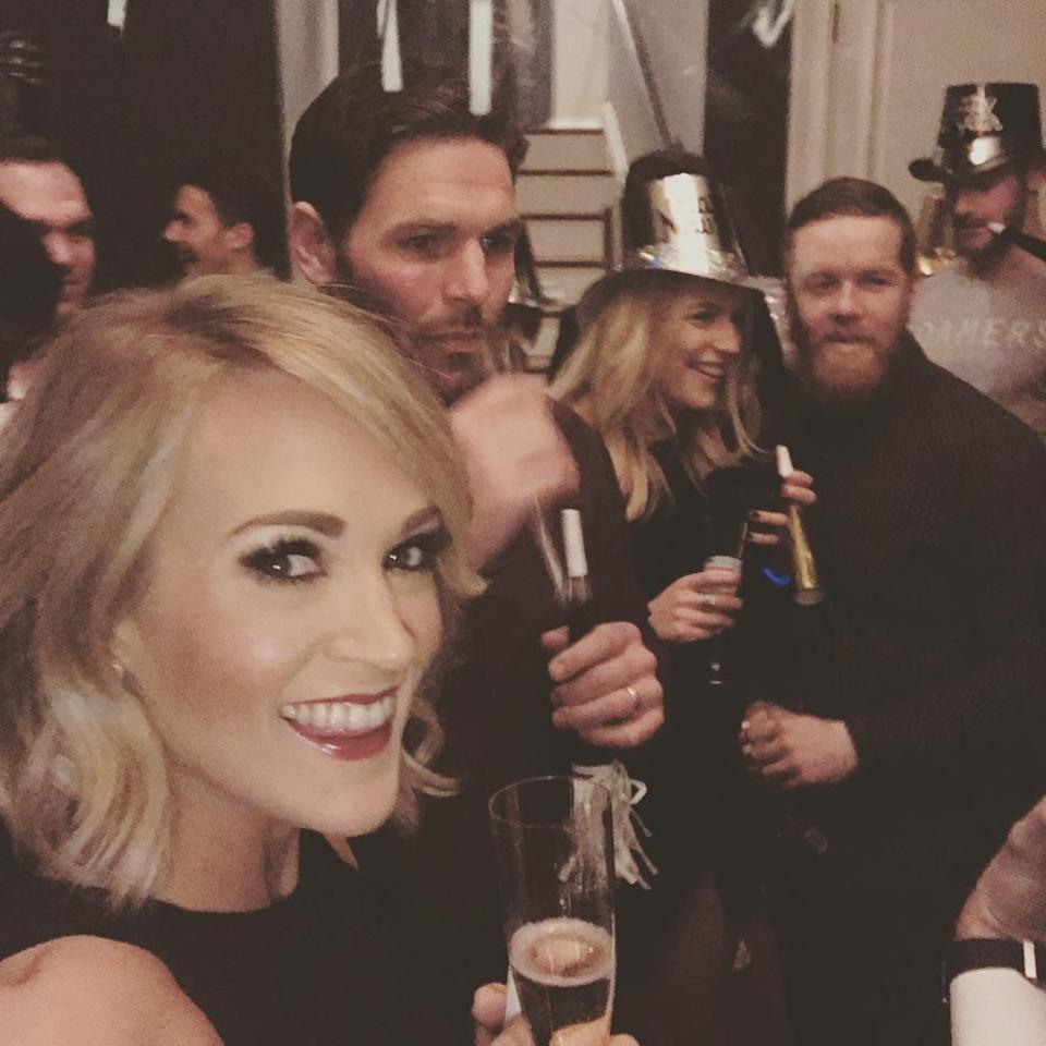 """<p>The country queen partied the night away with her hubby, Mike Fisher, and a glass filled with bubbly. (Photo: <a rel=""""nofollow"""" href=""""https://www.instagram.com/p/BOtgKXcjd_P/?taken-by=carrieunderwood"""">Instagram</a>) </p>"""