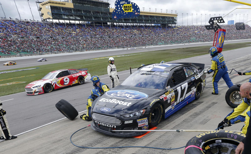 Driver Ricky Stenhouse Jr. (17) pits during a NASCAR Sprint Cup series auto race at Kansas Speedway in Kansas City, Kan., Sunday, Oct. 6, 2013. (AP Photo/Orlin Wagner)