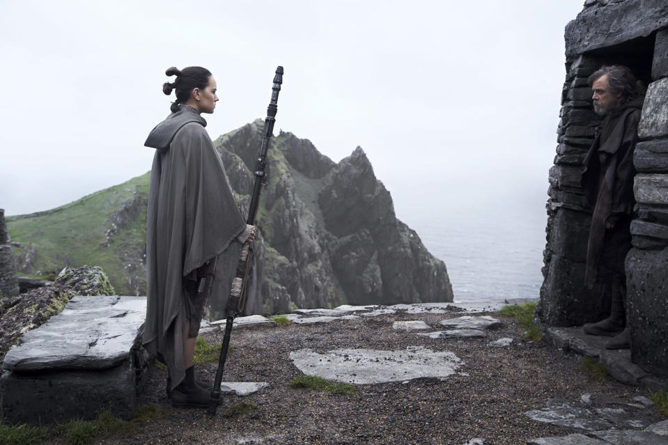Rey (Daisy Ridley) and Luke (Mark Hamill) stand amid the ruins of the first Jedi temple on Ahch-To. (Photo: Lucasfilm)
