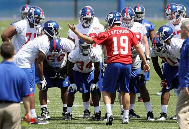 EAST RUTHERFORD, NJ - MAY 11: David Wilson #34 and Dan LeFevour #19 of the New York Giants huddles with his teamates during Giants minicamp at Timex Performance Center on May 11, 2012 in East Rutherford, New Jersey. (Photo by Jim McIsaac/Getty Images)