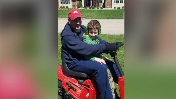 PHOTO: Brian Kelly, 5, rides with his dad, Dan Kelly, on the lawnmower before Kelly's deployment. (Courtesy Barbara Kelly)