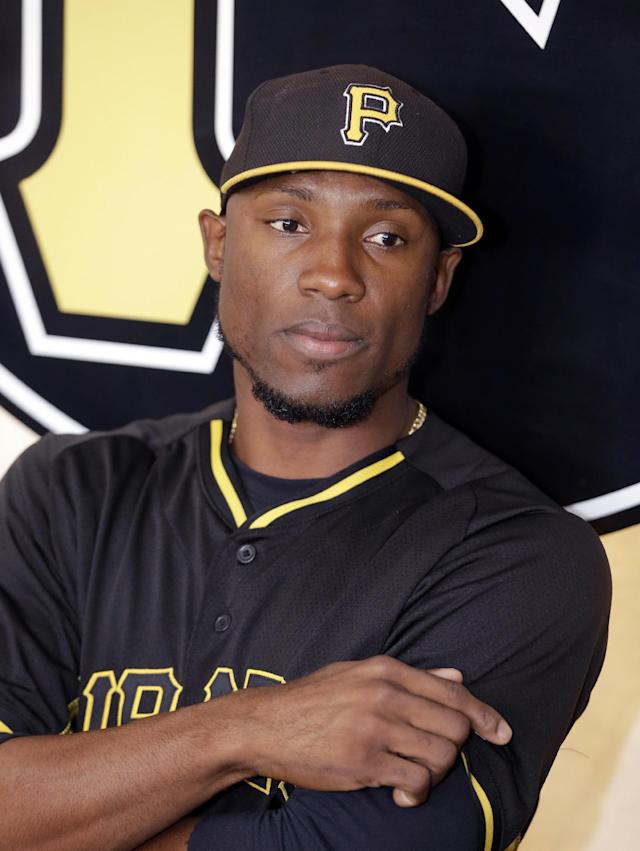 Pittsburgh Pirates left fielder Starling Marte is seen during during a news conference where his contract extension was discussed before a spring exhibition baseball game against the New York Yankees in Bradenton, Fla., Thursday, March 27, 2014. (AP Photo/Carlos Osorio)