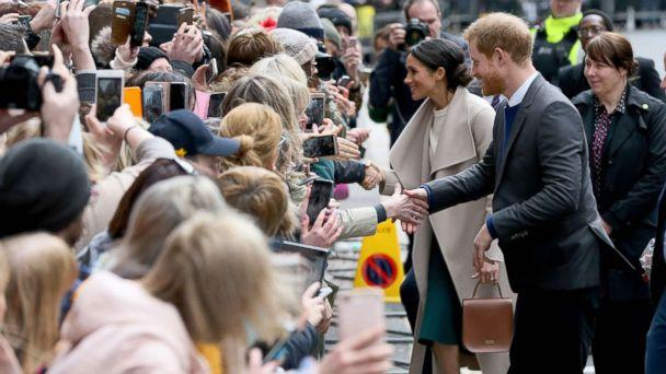PHOTO: Britain's Prince Harry and his fiancee, Meghan Markle, greet well-wishers after a visit at the historic building, The Crown Liquor Saloon in Belfast, March 23, 2018, where they will learn of the pub's heritage from members of the National Trust. (Paul Faith/AFP/Getty Images)