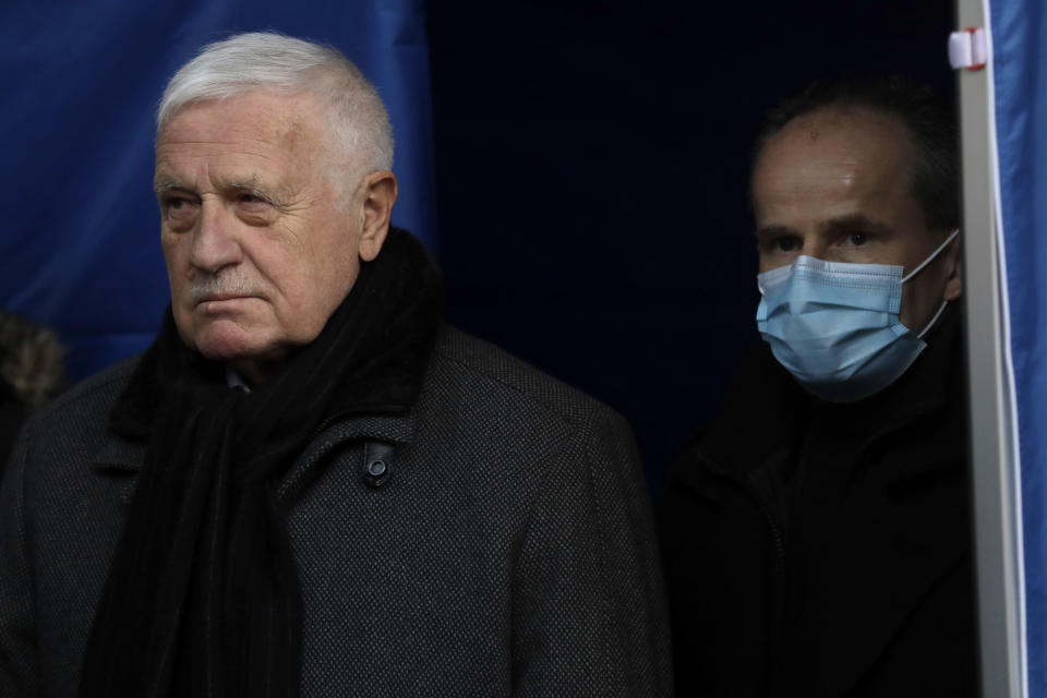 In this photo taken Sunday, Jan. 10, 2021, former Czech Republic's President Vaclav Klasu attends a protest against the government's restrictive measures imposed to contain the coronavirus pandemic at the Old Town Square in Prague, Czech Republic. Across the Balkans and the rest of the nations in the southeastern corner of Europe, a vaccination campaign against the coronavirus is overshadowed by heated political debates or conspiracy theories that threaten to thwart the process. In countries like the Czech Republic, Serbia, Bosnia, Romania and Bulgaria, skeptics have ranged from former presidents to top athletes and doctors. Nations that once routinely went through mass inoculations under Communist leaders are deeply split over whether to take the vaccines at all. (AP Photo/Petr David Josek)