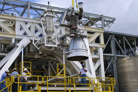 An AJ26 engine is placed in a test stand at NASA's Stennis Space Center.