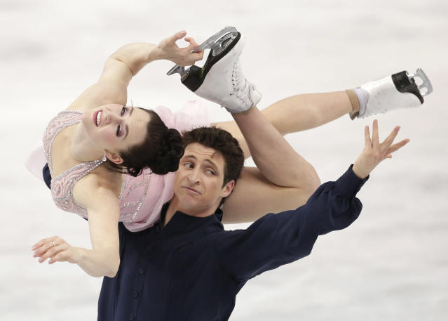 Tessa Virtue and Scott Moir of Canada compete in the ice dance free dance figure skating finals at the Iceberg Skating Palace during the 2014 Winter Olympics, Monday, Feb. 17, 2014, in Sochi, Russia. (AP Photo/Bernat Armangue)
