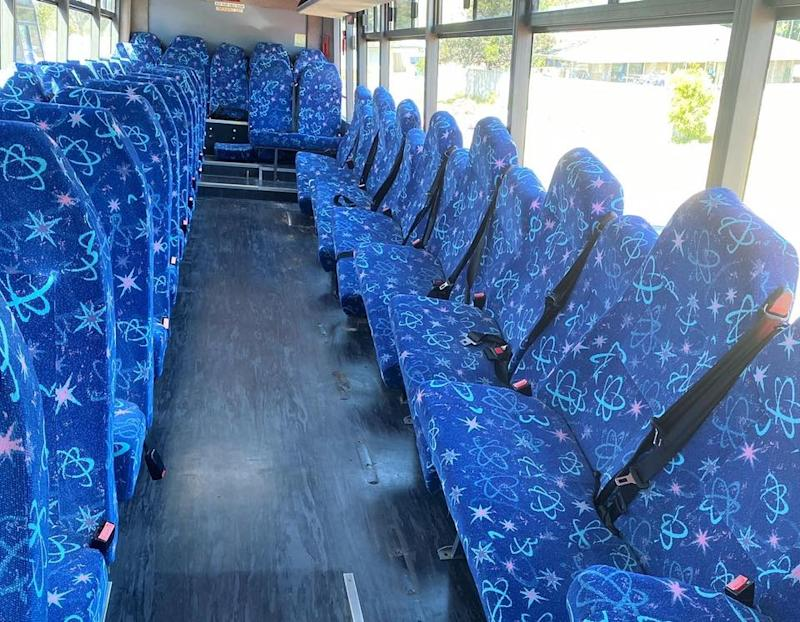 The interior of the Pascoe family bus before removing the seats