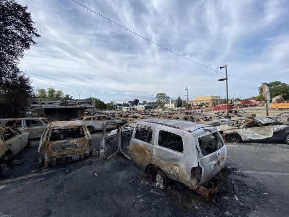 Cars burned during recent protests in Kenosha, Wisconsin. (Richard Hall / The Independent )