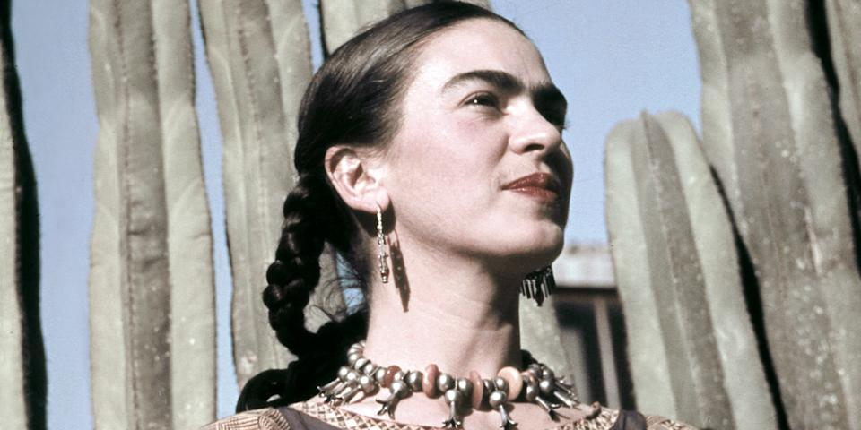Frida Kahlo poses for a photo at her home.