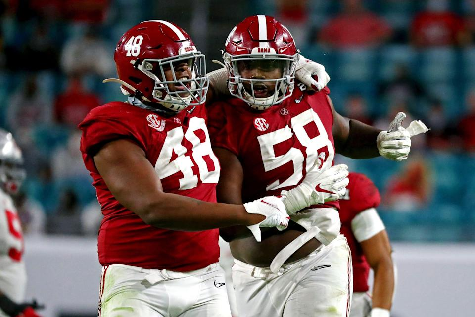 Alabama defensive lineman Christian Barmore (58) celebrated after a play against Ohio State in the national championship game.