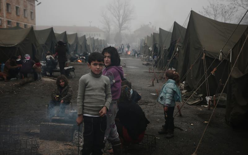 Syrian children try to stay warm near an open fire in front of their unheated tents in a refugee camp in the town of Harmanli, Bulgaria, Thursday, Nov. 21, 2013. Thousands of Syrian and other refugees from the Middle East, Asia and Africa, who find enough courage to make a dangerous journey from their war-ravaged states, often end up in the crammed settlements in the Balkans, including Bulgaria, Greece or Serbia, after being caught on the borders of wealthy Western European nations for attempting to cross illegally. (AP Photo/Valentina Petrova)