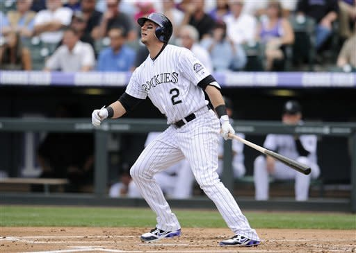 In this photo provided by the Colorado Rockies, Colorado Rockies' Troy Tulowitzki watches his two-run home run against the Arizona Diamondbacks in the first inning of a baseball game, Thursday, May 17, 2012, in Denver. Home plate umpire Jim Reynolds watches at left. The Diamondbacks won 9-7. (AP Photo/Colorado Rockies, Ryan McKee, Rich Clarkson and Associates, LLC)