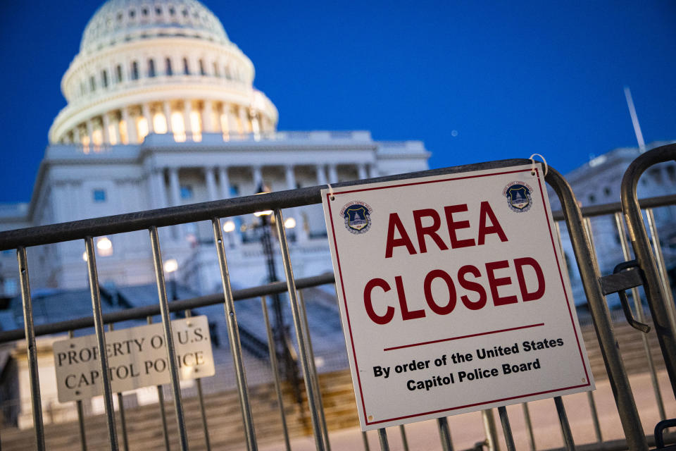 A sign denotes a portion of the West Front of the U.S. Capitol remains closed, as security fencing is removed on Sept. 19. Protesters gathered in Washington, D.C., for the '