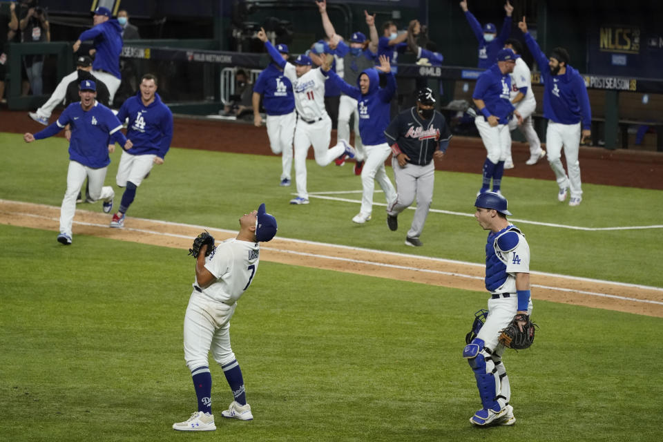 Los Angeles Dodgers starting pitcher Julio Urias celebrates their win against the Atlanta Braves in Game 7 of a baseball National League Championship Series Sunday, Oct. 18, 2020, in Arlington, Texas. (AP Photo/Tony Gutierrez)