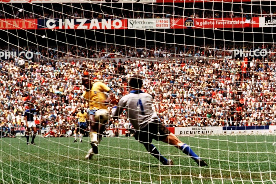 Brazil's Pele (left) sees his shot saved by Italy goalkeeper Enrico Albertosi (right)  (Photo by Peter Robinson/EMPICS via Getty Images)