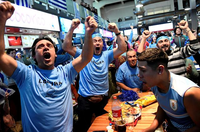 Soccer Football - World Cup - Group A - Uruguay vs Saudi Arabia - Montevideo, Uruguay - June 20, 2018. Fans celebrate a goal as they watch the broadcast of the match between Uruguay and Saudi Arabia at the Agricultural Market in Montevideo. REUTERS/Javier Calvelo