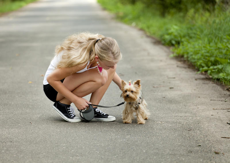 Beautiful girl with her beloved pet for a walk.