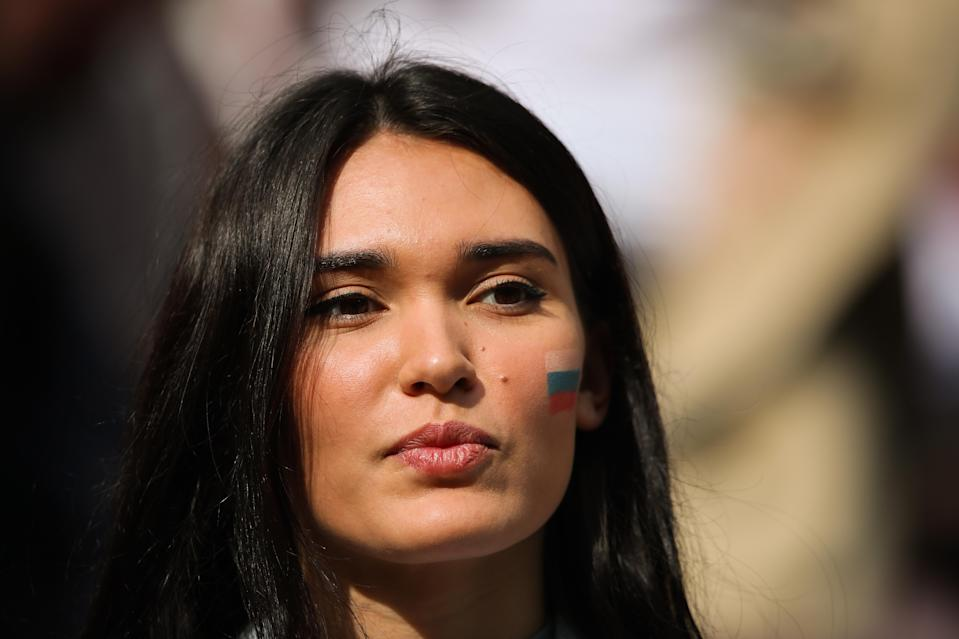 <p>A female fan of Russia looks on prior to the 2018 FIFA World Cup Russia group A match between Russia and Saudi Arabia at Luzhniki Stadium on June 14, 2018 in Moscow, Russia. (Photo by Matthew Ashton – AMA/Getty Images) </p>