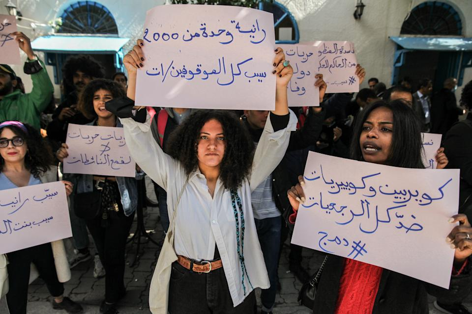 Protesters raise placards that read in Arabic, we queers are against all the retrograde Islamists, as others raise placards that read in Arabic, Release all young detainees, during a protest held on occasion of the appeal trial of the LGBTQI+ and feminist activist Rania Amdouni, outside the court of Tunis in Tunisia on March 17, 2021, to demand her release.  Ten days ago, the queer Rania Amdouni, 26-year-old, has been arrested and incarcerated in a women's prison after being sentenced at first instance to six months in jail for insulting police and abuse of morals. (Photo by Chedly Ben Ibrahim/NurPhoto via Getty Images)