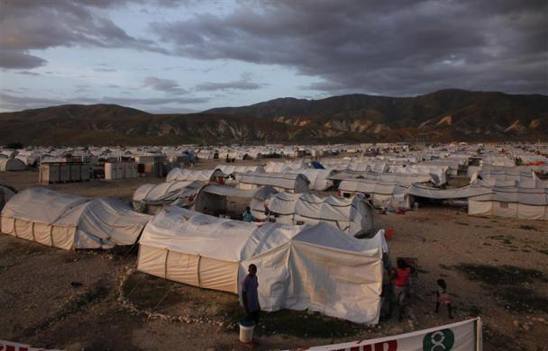 Earthquake victims sheltered at Camp Corail, a provisional camp, north of Port-au-Prince, walk among their tents, November 1, 2010.
