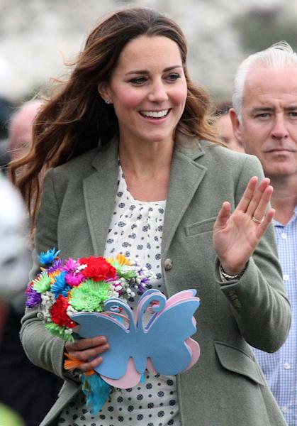 Kate, Duchess of Cambridge, made her first public appearance since the birth of Prince George as she joined husband Prince William, the Duke Of Cambridge, at Breakwater Country Park for the start of the Ring O' Fire Anglesey Coastal Ultra Marathon, a three-day, 135-mile foot race around the rugged coast of Anglesey, Wales, Friday, Aug. 30, 2013. (AP Photo / Paul Lewis, Pool)