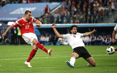"Eight goals in two games have averted Russia's nightmare of spending tens of millions of dollars on a World Cup only to go out in the group stage. Mohamed Salah meanwhile has been restricted to a penalty, lots of physio on his injured shoulder and an awkward meeting with Chechnya's warlord. Salah's penalty kick when Egypt already trailed 3-0 was a small reward for his hard work in the treatment room and gym. It pales, though, beside the potential dividend for Russia from 5-0 and 3-1 victories against two of the tournament's weaker sides. If all the hosts could hope for was to string their presence out to the point of respectability, their supporters now have something to be excited about beyond the stardust spread by other countries. If Saudi Arabia fail to beat Uruguay (and who would back them to win?) Russia will advance to the knock-out rounds for the first time since the collapse of the Soviet Union. The Saint Petersburg Stadium was not full for this second home triumph, but the 64,468 here were giddy as three second-half goals flew in inside 15 minutes (the first, a ludicrous own goal). Salah performed honourably after missing the 1-0 defeat to Uruguay, but to expect him to walk straight back in and rescue Egypt was fanciful, especially as he lacks team-mates of the quality of Roberto Firmino and Sadio Mane. His goal came in the 73rd minute after he was pulled down by the arm (this is becoming a pattern), apparently outside the Russia penalty box, until VAR showed it to be penalty. These Russia players are pretty much equal and indistinguishable. The Soviet system would have been proud of this mechanical team. It's as if their training stopped at pass and run, which they do well, and dispensed with the subtleties of the game, such as ingenuity and vision around the penalty box. Denis Cheryshev has been the best of them, and their energy and commitment ought to be acknowledged. Not that they will feel they had much choice in those respects. Russia have made a brilliant start to the tournament on home soil Credit: AFP They are all Russia have, and were cast into a home World Cup as the lowest-ranked team in the tournament with the unenviable task of matching the grandeur of the stadiums. Plainly this is going to be beyond them, however uplifting their 5-0 opening night win against Saudi Arabia - the biggest curtain-raising victory by a host country since 1934 - and this own-goal assisted win over Salah and company. Standing between the new Russian empire and progress to the Round of 16 was an Egypt side now emotionally dependent on Salah. The lauding of him before the game was at a level not even Liverpool fans could hope to match. His name was cheered at least three times louder than any other Egypt player, and each glimpse of him on the big screen ignited a new Egyptian party. In the game, Salah started wide-right, dispensing with defensive duties to try his luck against Yury Zhirkov, an old hand steeled for the fight. Denis Cheryshev scores Russia's second goal Credit: REuters It took Zhirkov 21 minutes to land a bang on the shoulder Salah injured in a tangle with Sergio Ramos in the Champions League final in Kiev. The challenge was fair, but spun Salah round, and soon the Premier League's golden boot winner moved to play more centrally. He was more effective there, his first real chance on goal coming with a turn and swivel on the edge of Russia's penalty box. But the shot from the pirouette slid wide. Egypt's campaign, though was about to take a comical turn, two minutes after the break, when Roman Zobnin miscued a shot after a bad punch by the goalkeeper, and Ahmed Fathy, the Egyptian captain, under pressure from Artem Dzyuba, took a wild swing at it and swiped it into his own net. Bare-chested Egyptian fans in Pharoah headgear looked on miserably. Egypt's defence, like Saudi Arabia's, disintegrated, conceding three times, twice abjectly . Egypt's forward Mohamed Salah dribbles past Russia's defender Sergey Ignashevich Credit: AFP With Salah's team still reeling from the own goal, Mario Fernandes cut a cross back for Cheryshev to double the lead, and then Ali Gabr failed to control a dropping ball on the edge of his box and allowed it to run to Dzyuba, the former star Russian striker who lost his way. Dzyuba's military salute for the goal was in tune with his combative work in unsettling Egypt's back four. The defensive ineptitude of opponents is helping Russia, but their probable advance will help maintain the interest of those who are ultimately paying for most of it - the Russian public, who have been treated to eight goals and plenty of workmanlike enterprise from their team. Salah, in effect, lost his World Cup campaign in the Champions League final, though he fought his way back to leave a small mark here. WorldCup - newsletter promo - end of article 9:03PM That's moved the boy Denis Level with He Who Must Not Be Mentioned in the race for the Golden Boot. 8:58PM Class piece from Jim White Seems absolutely ridiculous that these two fans have to travel to Russia to watch their team play football live. Why? Because they are women from Iran. https://t.co/pSLIeiuqvz— Jim White (@jimw1) June 19, 2018 8:57PM Uruguay will have enjoyed that. Now a World Cup last-16 place is theirs for the taking if they beat Saudi Arabia. 8:55PM Group A Table 8:54PM Nice! Best goal difference by a host nation through two #WorldCup games: +7 ���� 2018 Russia +7 ���� 1998 France (won title) +6 ���� 1934 Italy (won title) +5 ���� 1930 Uruguay (won title)— Paul Carr (@PaulCarrTM) June 19, 2018 8:52PM Full time: Russia 3 Egypt 1 Hard lines for Egypt, but Russia are having a bit of a moment and deserved their win. 8:49PM 90+ mins: there will be four minutes added Warda and Kudryashov square up. Kudryashov looks like he could eat Warda for breakfast and still have room for pancakes. The hosts are, barring an astonishing Saudi Arabia result, going through. 8:47PM 89 mins: Russia 3 Egypt 1 Nice move, Salah nearly dancing through, they get the break of the ball and Warda, from the right, hits it wide of the post. 8:46PM 86 mins Warda with a useful cross in. Since they, erm, went 3-0 down Egypt have played with a lot more vim. Also, other attacking players have started trying to do something rather than just looking to Salah. This is the problem with a one man team, obvs. 8:45PM 85 mins: Russia 3 Egypt 1 Egypt having the odd 1/4 chance but to be honest this feels remote in the extreme as a possibility. 8:42PM 84 mins: Russia 3 Egypt 1 Kahraba on, Mohsen off. Yuri Zhirkov is replaced by Fedor Kudryashov. 8:38PM 80 mins: Russia 3 Egypt 1 Egypt getting greedy, now they want another pen. Mohsen hits the deck. Kutepov the accused. No penalty. And I'll tell you why not: because Mohsen had fouled HIM. 8:37PM 79 mins: Golovin controls the ball majestically, nips past Gabr and waits for the foul, and the inevitable freekick. Ref doesn't give it. Snigger. Smolov comes on for Dzubya. 8:33PM 75 mins: Russia 3 Egypt 1 Kuziaev comes on, the dangerman Cheryshev off. Russia have a decent opportunity to slam the coffin lid down when Samedov delivers a useful freekick to the back stick. Ignashevich's header is saved. 8:31PM VAR to the rescue Again, VAR gets there. But poor refereeing. Always been a penalty.— Matt Smith (@msmith850) June 19, 2018 8:31PM GOAL! Russia 3 Egypt 1 (Salah 73 pen) He's wellied that! Bosh. No messing from Mo Salah. Is that an improbable lifeline? 8:30PM 71 mins: Russia 3 Egypt 0 Salah is hauled down. To most viewers, it is clear that it is inside the box. But not to the referee though. He gives it outside the box but fortunately the VAR comes to the rescue. A PENALTY IS AWARDED Credit: BBC 8:25PM 66 mins Fed by Salah with a nice ball, Trezeguet has a shot wide, and that will be Trezeguet's last contribution. He's getting the hook, and here comes Sobhi. 8:22PM 65 mins Warda on, Elneny off. Egypt have a freekick, Gabr tries to make amends for his defensive spinelessness with a header. No. 8:20PM GOAL! Russia 3 Egypt 0 (Dzyuba 62) Another one! Oh dear, this is turning into a horrible night for the Pharoahs. Route one, big Dzyuba chests the ball down and it's men against boys as Gabr and Hegazi crumble and let him through. Hammers it home and that, my friends, is the night boat to Cairo. Artem Dzyuba of Russia scores Credit: Getty 8:16PM GOAL! Russia 2 Egypt 0 (Cheryshev 59) Ooh, that is going to be the killer blow, surely. Nice work from Figueira Fernandes, heart and energy down the right to join the attack. Pulls the ball back, and there is the deadly Denis Cheryshev to slot the ball home. That's his third of the tournament by the way, and it looks likely that it is going to send Russia through... and send poor Egypt home. 8:14PM No OG no fun There were no own-goals at all at the 1958 and 1962 World Cups. What miserable times they must have been.— Nick Miller (@NickMiller79) June 19, 2018 8:13PM 55 mins: Russia 1 Egypt 0 That was the moment? Maybe? The ball is played into the Russian box, knockdown, Salah has it at his feet eight yards out.... but he cannot get it out from under him and the desperate Russians can clear. Fully fit, he jinks and smashes that. But he is not confident in his body. 8:10PM 52 mins: Russia 1 Egypt 0 Russians enjoying a couple of corners. At this rate (5 own goals in 17 matches), this World Cup will have 19 own goals. The record most in a single World Cup is 6, set in 1998. #WorldCup#RUS#EGY— Gracenote Live (@GracenoteLive) June 19, 2018 8:04PM OWN GOAL! by Fathy: Russia 1 Egypt 0 Aw, that is rotten luck for Egypt, although their keeper must carry his fair share of blame. Golovin crosses it in, the keeper comes out with a flappy, silly punch. Shoulda caught that. Instead, he punches, the Russian 11 Zobnin drills it back in and a panicking Fathy stabs it into his own net. (Fathy OG 47 mins) Dreadful shot by Zobnin by the way, would have practically gone out for a corner had Fathy not intervened. Egypt's goalkeeper Mohamed El Shenawy (R) watches as the ball ends up in his net after a deflection by Egypt's defender Ahmed Fathi (L) Credit: AFP/Getty 8:03PM 46 mins: Russia 0 Egypt 0 Always a shame to see a brilliant player not at his best due to injury. But hopefully Mo Salah can weave a bit of magic. 8:00PM This shows Salah's position (10) Average touch positions (half time) He's basically playing as a narrow advanced forward. Alan Shearer sums it up well on BBC: ""Mo Salah, you can tell, is only 70-75% fit and they know that - they're protecting him, he's not running back and they're just trying to get the ball up to him."" 7:57PM Pretty fair Russia vs Egypt shots on goal 7:46PM Half time: Russia 0 Egypt 0 That'll do it for the half, not many chances, but plenty of energy. 7:44PM 42 mins Fun, B- quality, end-to-end stuff, here are the Russians with a corner. Gabr involved in a good old fashioned grappling contest with Dzyuba. Risky business in these VAR times... 7:42PM 40 mins There's our boy! Class from Salah, Mohsen dummies, Salah gets it and spins away from his man. Peach of a curling effort but not quite. 7:40PM 37 mins Lovely counter by Egypt, but it starts in bizarre fashion when the ball hits the ref, wrong-footing everyone! Elneny with a great ball in and Mohsen should have done a lot better. 7:35PM 34 mins Nice ball in! Mohsen just misses out to Figueira Fernandes of Russia. More even now. 7:34PM 33 mins Better spell from Egypt. Passing it, higher up the pitch. Looking slicker, ball into the area from Shafy is flicked on. Salah nearly there at the back stick! Corner. Delivery is poor. 7:33PM 30 mins: Russia 0 Egypt 0 Enjoyable game so far. Russia unsophisticated but useful, got some pace, got some who can deliver the ball, attack in numbers. Egypt are unbalanced. They need to just get a bit of the ball, play themselves into this. 7:28PM 27 mins: Russia 0 Egypt 0 Decent from Salah as he holds it up to tee up Trézéguet , whose shot is charged down. But it is a momentary respite: here come the Russians again. 7:27PM 25 mins: Russia 0 Egypt 0 This Egypt defence are making some blunders and I think they are going to be sorry. A ball is played in by Cheryshev. Keeper El-Shenawy comes, and is barged off it by Hegazi. Don't panic! 7:25PM 22 mins Salah is not doing a lot. And as I say, he is not offering anything defensively, just standing out on the right wing. Here come the Russians down the left. Gazinskii crosses and the big lad Dzyuba gets up well but glances his header too fine. 7:19PM 18 mins: Russia 0 Egypt 0 Zhirkov takes a freekick but is wasteful with the delivery. But Russia get a lucky break when it rebounds out to Cheryshev. he has a crack, and it is not far over. 7:16PM 16 mins Lovely run from Trézéguet down the inside-left, he tries to bend it in at the far post and he is not far at all from achieving that end. 7:15PM 14 mins: Russia 0 Egypt 0 El Said spins away from Kutepov and was fouled. From a corner, Egypt have a headed chance. Attempt Saved: Russia 0 - 0 Egypt (Marwan Mohsen, 15 min) Behind for another corner. Another good ball in, cleared but only as far as the corner flag. Good spell for the visitors, their best of the match so far. 7:13PM 13 mins: Russia 0 Egypt 0 That's it! Salah gets a long ball on the right, gives it inside and goes into the box. He is stopped by multiple Russians. 7:11PM 11 mins: Russia 0 Egypt 0 Samedov and Figueira Fernandes link up well down the right but the latter cannot quite find the final ball. 7:10PM 10 mins: Russia 0 Egypt 0 Very encouraging start from the hosts. Egypt pinned back. Salah hasn't featured. Also: Salah is not tracking back, which is fine in and of itself but somebody else needs to help out the right back in which case. 7:08PM 8 mins: Russia 0 Egypt 0 It's all Russia. Egypt cannot get out. 7:08PM 6 mins: Russia 0 Egypt 0 Defensive blunder by Egypt! Sloppy, dawdling play out from the back, Golovin pinches it and races forward. He is disappointed not to have done better with the shot. 7:07PM 5 mins: Russia 0 Egypt 0 Russia have the game's first corner.. Taken short, and it is played in by Samedov, headed by the veteran Ignashevich. Not troubling anyone, that. 7:04PM 3 mins Plenty of atmos, some beefy challenges but neither side able to dominate so far. Russia looking for raking balls to their hefty forward Artem Dzyuba. 7:01PM 1 mins: Russia 0 Egypt 0 Egypt, in white, kick off. 7:01PM And Egypt Egypt side Credit: BBC 6:58PM Here's how Russia should line up Credit: BBC 6:56PM Russian anthem Powerful stuff. 6:55PM Egyptian anthem being belted out around the stadium, they seem to have got a few in. Egypt's forward Mohamed Salah... he's in! Credit: AFP/Getty 6:50PM Noice Russia ���� fans gather outside the entrance to Red Square as anticipation mounts ahead of the hosts' group match against Egypt ���� in St. Petersburg. Mo Salah starts for The Pharaohs #RUSEGY ⁦@FIFAWorldCup⁩ ⁦@RT_com⁩ pic.twitter.com/TEqBth3fTC— Kate Partridge (@KatePartridge33) June 19, 2018 6:49PM Danny Murphy Bit over-dressed, aren't you? Like you just stepped out of a bookies: Danny Murphy Credit: BBC 6:48PM Fans Credit: BBC 6:35PM Who's having a good tournament? 6:34PM Where's your money, then? Here is our betting guide to a tasty fixture. Russia: Akinfeev, Fernandes, Kutepov, Ignashevich, Zhirkov, Zobnin, Gazinsky, Samedov, Golovin, Cheryshev, Dzyuba. Subs: Lunev, Semenov, Kuzyaev, Dzagoev, Smolov, Kudryashov, Granat, Aleksey Miranchuk, Anton Miranchuk, Erokhin, Smolnikov, Gabulov. Egypt: El Shenawy, Fathi, Gabr, Hegazi, Abdel-Shafy, Hamed, Elneny, Salah, Said, Trezeguet, Mohsen. Subs: El Hadary, Elmohamady, Gaber, Morsy, Kahraba, Ashraf, Sobhi, Hamdy, Shikabala, Samir, Warda, Ekramy. Referee: Enrique Caceres (Paraguay) 6:21PM Salah news! The Premier League's top scorer adds some much-needed bite to an Egyptian attack that struggled to threaten Uruguay in a 1-0 loss Friday. On the other side, Russia winger Denis Cheryshev has promoted to the starting lineup after scoring twice as a substitute in Thursday's tournament-opening 5-0 win over Saudi Arabia. Egypt: Mohamed Elshenawy, Ali Gabr, Ahmed Hegazy, Mohamed Abdelshafy, Ahmed Fathi, Tarek Hamed, Mohamed Elneny, Abdalla Said, Mohamed Salah, Mahmoud Hassan, Marwan Mohsen. Russia: Igor Akinfeev, Mario Fernandes, Ilya Kutepov, Sergei Ignashevich, Denis Cheryshev, Yuri Gazinsky, Fyodor Smolov, Roman Zobnin, Alexander Golovin, Yuri Zhirkov, Alexander Samedov. 6:20PM Heartwarming news! Suspended former FIFA president Sepp Blatter has arrived in Moscow for a World Cup visit at the invitation of Russian President Vladimir Putin. Blatter posed for photographs with people on his arrival at a five-star hotel downtown. The 82-year-old former FIFA president is banned from official football duty until October 2021 for financial misconduct during this 17-year rule. This is Blatter's first public appearance outside his native Switzerland since July 2015 when the World Cup qualifying draw was conducted in St. Petersburg. Blatter shared the stage that day with Putin and could meet with the Russian president this week. The FIFA ban does not prevent Blatter attending games and he is expected to see Portugal play Morocco on Wednesday at Luzhniki Stadium. 5:49PM And please welcome your hosts.... Russia! Starting Eleven @TeamRussia vs @Pharaohs#Rusia2018#RUSEGYpic.twitter.com/HLD5EZt081— Сборная России (@TeamRussia) June 19, 2018 Playing in their controversial 4-4-4 formation and giving a start to an old geezer who has come in the wrong PE kit. 5:47PM Where is the match? World Cup 2018 stadium: Saint Petersburg Stadium 5:46PM More on Mo Egypt striker Mohamed Salah will make his first appearance at the World Cup after being named in the starting line-up for tonight's match with Russia, the Egyptian Football Association has announced. The Liverpool forward has been sidelined since injuring his shoulder during last month's Champions League final defeat against Real Madrid. Salah, who was an unused substitute in Egypt's Group A opener against Uruguay on Friday, will lead his side as they face hosts Russia at Krestovsky Stadium in an attempt to bounce back from that defeat with a result. 5:45PM Here's all our reaction to the England game Tunisia 1 England 2 