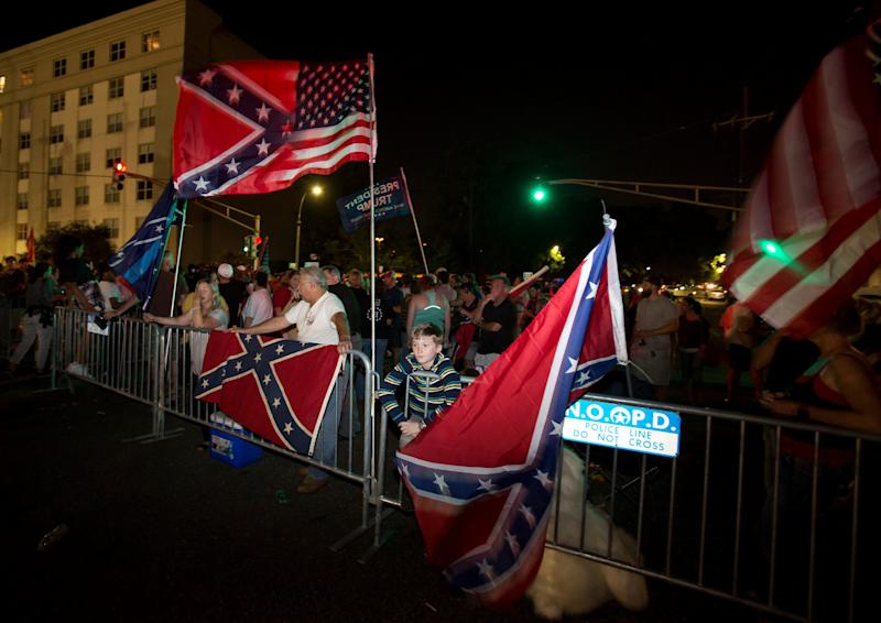 Pro-monument protesters gather in New Orleans - Credit: ap