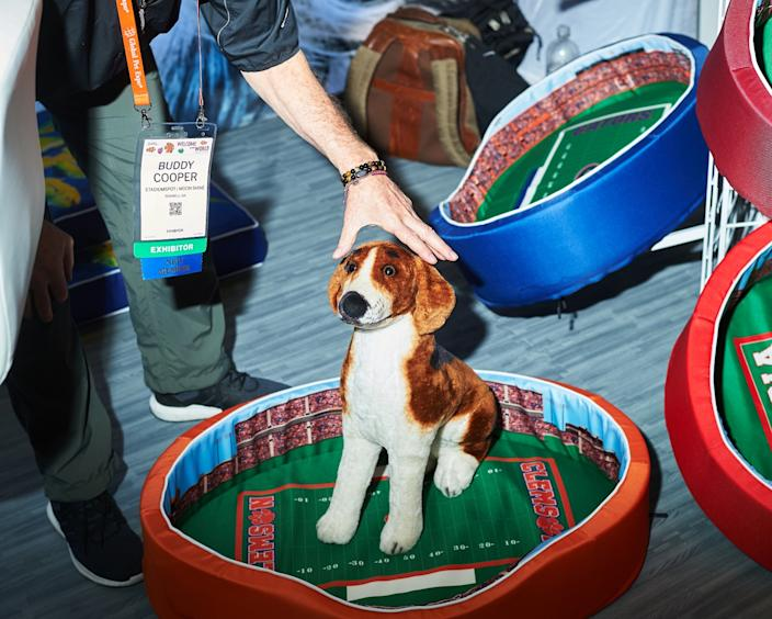 """A stuffed animal is used to show off a football-themed pet bed. <span class=""""copyright"""">(Zack Wittman / For The Times )</span>"""