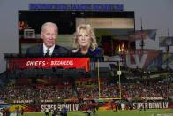 President Joe Biden and first lady Dr. Jill Biden are seen on a scoreboard screen delivering a message before the NFL Super Bowl 55 football game between the Kansas City Chiefs and Tampa Bay Buccaneers, Sunday, Feb. 7, 2021, in Tampa, Fla. (AP Photo/Chris O'Meara)