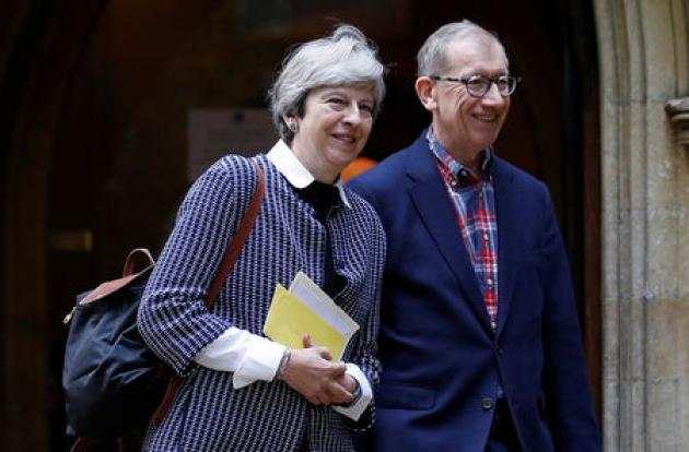 Britain's PM May, husband have no direct offshore investments