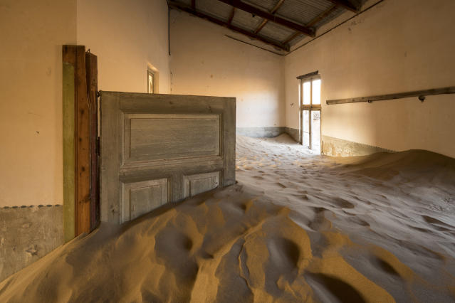 <p>Eventually the desert reclaimed the town and sand started filling the homes. (Photo: David Swindler/Caters News) </p>